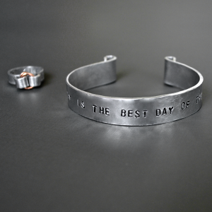 personalized wide hammered aluminum cuff bracelet with curl top aluminum ring