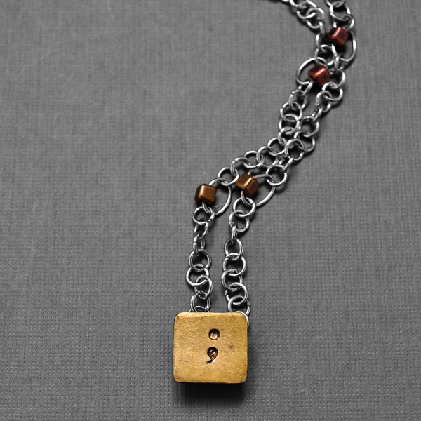 pierced square semicolon necklace